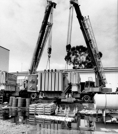 A transformer being lifted by crane at the Kingston Electrical Workshop 08/12/1987