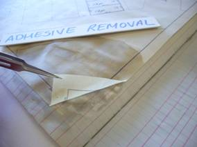 Solubilised adhesive releases document