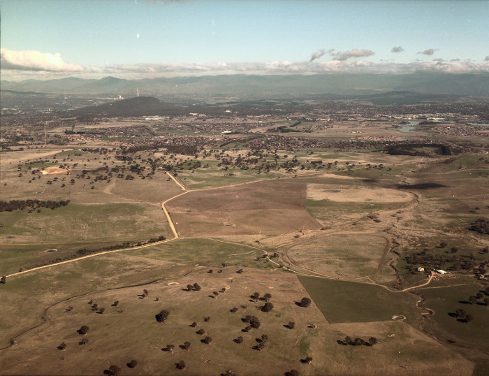 Gungahlin in May 1986. Looking south-west along Gundaroo Road and Ginninderra Creek from above 'Horse Park' (now Jacka). (Source: 5313 - Office of Surveyor General Photos)