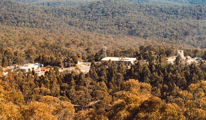 View of Honeysuckle Creek from the Water tank in 1985, note the 'headless' antenna; (99/11078)