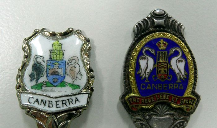 Examples of poor representations of the Canberra Coat of Arms on souvenir spoons